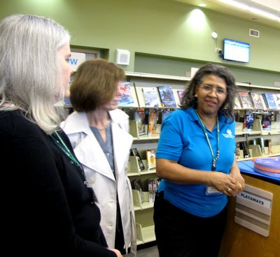 Dana Newman, Chief, Public Services and Branch Management, and Terry Bowen, Chief Human Resources and Ruby Jaby Branch Manager of the Crofton Community Library
